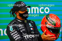 Race winner Lewis Hamilton (GBR) Mercedes AMG F1 is presented with the helmet of Michael Schumacher (GER) in parc ferme after equalling the record for the number of F1 victories. 11.10.2020. Formula 1 World Championship, Rd 11, Eifel Grand Prix, Nurbugring, Germany, Race Day.