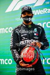 Race winner Lewis Hamilton (GBR) Mercedes AMG F1 with the helmet of Michael Schumacher (GER) by Mick Schumacher (GER) in parc ferme after equalling the record for the number of F1 victories. 11.10.2020. Formula 1 World Championship, Rd 11, Eifel Grand Prix, Nurbugring, Germany, Race Day.