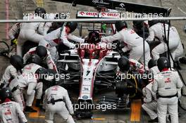 Kimi Raikkonen (FIN) Alfa Romeo Racing C39 makes a pit stop. 11.10.2020. Formula 1 World Championship, Rd 11, Eifel Grand Prix, Nurbugring, Germany, Race Day.