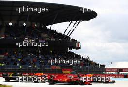 Max Verstappen (NLD) Red Bull Racing RB16 and Charles Leclerc (MON) Ferrari SF1000 at the start of the race. 11.10.2020. Formula 1 World Championship, Rd 11, Eifel Grand Prix, Nurbugring, Germany, Race Day.