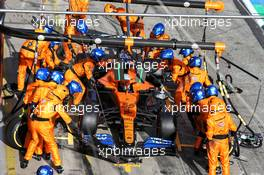 Carlos Sainz Jr (ESP) McLaren MCL35 makes a pit stop. 11.10.2020. Formula 1 World Championship, Rd 11, Eifel Grand Prix, Nurbugring, Germany, Race Day.