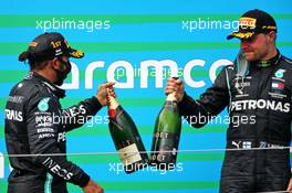 (L to R): Race winner Lewis Hamilton (GBR) Mercedes AMG F1 with third placed team mate Valtteri Bottas (FIN) Mercedes AMG F1 on the podium. 19.07.2020. Formula 1 World Championship, Rd 3, Hungarian Grand Prix, Budapest, Hungary, Race Day.