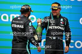 (L to R): Race winner Lewis Hamilton (GBR) Mercedes AMG F1 celebrates with third placed team mate Valtteri Bottas (FIN) Mercedes AMG F1. 19.07.2020. Formula 1 World Championship, Rd 3, Hungarian Grand Prix, Budapest, Hungary, Race Day.