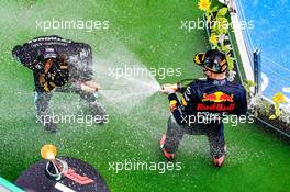 (L to R): Race winner Lewis Hamilton (GBR) Mercedes AMG F1 celebrates on the podium with second placed Max Verstappen (NLD) Red Bull Racing. 19.07.2020. Formula 1 World Championship, Rd 3, Hungarian Grand Prix, Budapest, Hungary, Race Day.