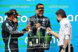 (L to R): Race winner Lewis Hamilton (GBR) Mercedes AMG F1 with third placed team mate Valtteri Bottas (FIN) Mercedes AMG F1 and Peter Bonnington (GBR) Mercedes AMG F1 Race Engineer on the podium. 19.07.2020. Formula 1 World Championship, Rd 3, Hungarian Grand Prix, Budapest, Hungary, Race Day.