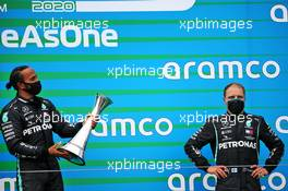 (L to R): Race winner Lewis Hamilton (GBR) Mercedes AMG F1 celebrates on the podium with team mate Valtteri Bottas (FIN) Mercedes AMG F1. 19.07.2020. Formula 1 World Championship, Rd 3, Hungarian Grand Prix, Budapest, Hungary, Race Day.