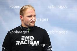 Valtteri Bottas (FIN) Mercedes AMG F1 as the grid observes the national anthem.