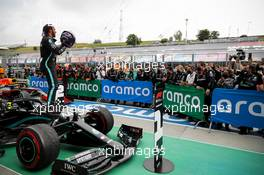 Race winner Lewis Hamilton (GBR) Mercedes AMG F1 W11 celebrates in parc ferme.