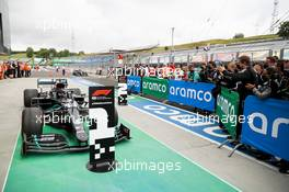 Race winner Lewis Hamilton (GBR) Mercedes AMG F1 W11 in parc ferme.