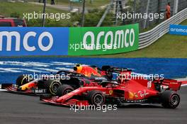 Charles Leclerc (MON) Ferrari SF1000 and Alexander Albon (THA) Red Bull Racing RB16 battle for position. 19.07.2020. Formula 1 World Championship, Rd 3, Hungarian Grand Prix, Budapest, Hungary, Race Day.
