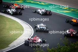 Antonio Giovinazzi (ITA) Alfa Romeo Racing C39 follows George Russell (GBR) Williams Racing FW43 at the start of the race. 19.07.2020. Formula 1 World Championship, Rd 3, Hungarian Grand Prix, Budapest, Hungary, Race Day.