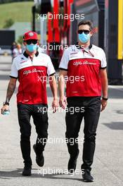 Kimi Raikkonen (FIN) Alfa Romeo Racing with Will Ponissi (ITA) Alfa Romeo Racing Communications Coordinator. 16.07.2020. Formula 1 World Championship, Rd 3, Hungarian Grand Prix, Budapest, Hungary, Preparation Day.