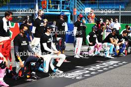 Drivers make their end racism message on the grid minus Lewis Hamilton (GBR) Mercedes AMG F1 and Sebastian Vettel (GER) Ferrari. 06.09.2020. Formula 1 World Championship, Rd 8, Italian Grand Prix, Monza, Italy, Race Day.