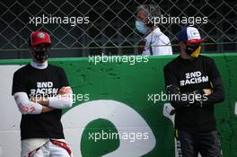 Antonio Giovinazzi (ITA) Alfa Romeo Racing C39 and Esteban Ocon (FRA) Renault F1 Team RS20. 06.09.2020. Formula 1 World Championship, Rd 8, Italian Grand Prix, Monza, Italy, Race Day.