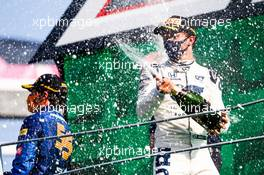 Race winner Pierre Gasly (FRA) AlphaTauri celebrates on the podium.