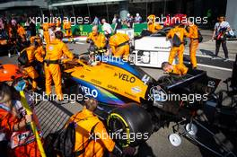 Lando Norris (GBR) McLaren MCL35 in the pits while the race is stopped. 06.09.2020. Formula 1 World Championship, Rd 8, Italian Grand Prix, Monza, Italy, Race Day.
