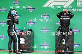 (L to R): Valtteri Bottas (FIN) Mercedes AMG F1 and team mate Lewis Hamilton (GBR) Mercedes AMG F1 in parc ferme. 25.10.2020. Formula 1 World Championship, Rd 12, Portuguese Grand Prix, Portimao, Portugal, Race Day.