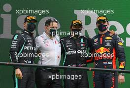 The podium (L to R): Valtteri Bottas (FIN) Mercedes AMG F1, second; Peter Bonnington (GBR) Mercedes AMG F1 Race Engineer, Lewis Hamilton (GBR) Mercedes AMG F1, race winner; Max Verstappen (NLD) Red Bull Racing, third. 25.10.2020. Formula 1 World Championship, Rd 12, Portuguese Grand Prix, Portimao, Portugal, Race Day.