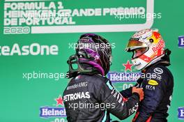 Lewis Hamilton (GBR) Mercedes AMG F1 celebrates his record breaking 92nd Grand Prix victory in parc ferme with Max Verstappen (NLD) Red Bull Racing. 25.10.2020. Formula 1 World Championship, Rd 12, Portuguese Grand Prix, Portimao, Portugal, Race Day.