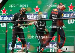 (L to R): Race winner Lewis Hamilton (GBR) Mercedes AMG F1 celebrates on the podium with Valtteri Bottas (FIN) Mercedes AMG F1 and Max Verstappen (NLD) Red Bull Racing. 25.10.2020. Formula 1 World Championship, Rd 12, Portuguese Grand Prix, Portimao, Portugal, Race Day.