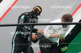 (L to R): Race winner Lewis Hamilton (GBR) Mercedes AMG F1 celebrates on the podium with Peter Bonnington (GBR) Mercedes AMG F1 Race Engineer. 25.10.2020. Formula 1 World Championship, Rd 12, Portuguese Grand Prix, Portimao, Portugal, Race Day.