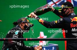 (L to R): Race winner Lewis Hamilton (GBR) Mercedes AMG F1 celebrates on the podium with Max Verstappen (NLD) Red Bull Racing. 25.10.2020. Formula 1 World Championship, Rd 12, Portuguese Grand Prix, Portimao, Portugal, Race Day.
