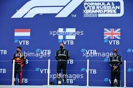 The podium (L to R): Max Verstappen (NLD) Red Bull Racing, second; Valtteri Bottas (FIN) Mercedes AMG F1, race winner; Lewis Hamilton (GBR) Mercedes AMG F1, third. 27.09.2020. Formula 1 World Championship, Rd 10, Russian Grand Prix, Sochi Autodrom, Sochi, Russia, Race Day.