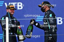 (L to R): Race winner Valtteri Bottas (FIN) Mercedes AMG F1 celebrates on the podium with third placed team mate Lewis Hamilton (GBR) Mercedes AMG F1. 27.09.2020. Formula 1 World Championship, Rd 10, Russian Grand Prix, Sochi Autodrom, Sochi, Russia, Race Day.
