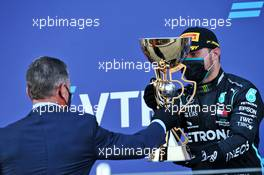 Race winner celebrates on the podium with Dmitry Kozak (RUS) Former Russian Deputy Prime Minister. 27.09.2020. Formula 1 World Championship, Rd 10, Russian Grand Prix, Sochi Autodrom, Sochi, Russia, Race Day.