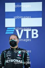 Race winner Valtteri Bottas (FIN) Mercedes AMG F1 on the podium. 27.09.2020. Formula 1 World Championship, Rd 10, Russian Grand Prix, Sochi Autodrom, Sochi, Russia, Race Day.