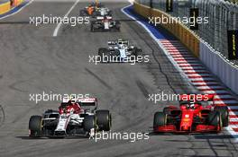 Antonio Giovinazzi (ITA) Alfa Romeo Racing C39 and Sebastian Vettel (GER) Ferrari SF1000 battle for position. 27.09.2020. Formula 1 World Championship, Rd 10, Russian Grand Prix, Sochi Autodrom, Sochi, Russia, Race Day.