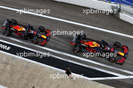 Alexander Albon (THA) Red Bull Racing RB16 and Max Verstappen (NLD) Red Bull Racing RB16. 26.09.2020. Formula 1 World Championship, Rd 10, Russian Grand Prix, Sochi Autodrom, Sochi, Russia, Qualifying Day.