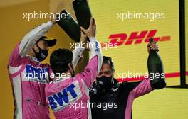 Andy Stevenson (GBR) Racing Point F1 Team Manager celebrates on the podium with race winner Sergio Perez (MEX) Racing Point F1 Team and Lance Stroll (CDN) Racing Point F1 Team. 06.12.2020. Formula 1 World Championship, Rd 16, Sakhir Grand Prix, Sakhir, Bahrain, Race Day.