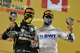 (L to R): Esteban Ocon (FRA) Renault F1 Team celebrates his second position on the podium with third placed Lance Stroll (CDN) Racing Point F1 Team. 06.12.2020. Formula 1 World Championship, Rd 16, Sakhir Grand Prix, Sakhir, Bahrain, Race Day.