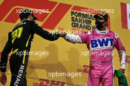 (L to R): Esteban Ocon (FRA) Renault F1 Team celebrates his second position on the podium with race winner Sergio Perez (MEX) Racing Point F1 Team. 06.12.2020. Formula 1 World Championship, Rd 16, Sakhir Grand Prix, Sakhir, Bahrain, Race Day.