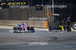 Lance Stroll (CDN) Racing Point F1 Team RP20 and Esteban Ocon (FRA) Renault F1 Team RS20 battle for position. 06.12.2020. Formula 1 World Championship, Rd 16, Sakhir Grand Prix, Sakhir, Bahrain, Race Day.