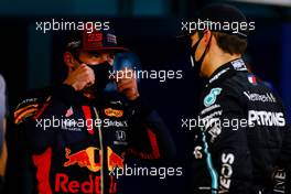 (L to R): Max Verstappen (NLD) Red Bull Racing with George Russell (GBR) Mercedes AMG F1 in qualifying parc ferme. 05.12.2020. Formula 1 World Championship, Rd 16, Sakhir Grand Prix, Sakhir, Bahrain, Qualifying Day.