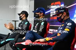 (L to R): George Russell (GBR) Mercedes AMG F1 with Valtteri Bottas (FIN) Mercedes AMG F1 and Max Verstappen (NLD) Red Bull Racing in the post qualifying FIA Press Conference. 05.12.2020. Formula 1 World Championship, Rd 16, Sakhir Grand Prix, Sakhir, Bahrain, Qualifying Day.