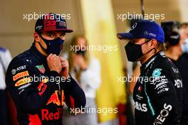 (L to R): Max Verstappen (NLD) Red Bull Racing with pole sitter Valtteri Bottas (FIN) Mercedes AMG F1 in qualifying parc ferme. 05.12.2020. Formula 1 World Championship, Rd 16, Sakhir Grand Prix, Sakhir, Bahrain, Qualifying Day.