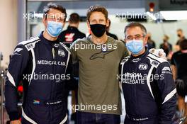 Romain Grosjean (FRA) Haas F1 Team (Centre) with Alan Van Der Merwe (RSA) FIA Medical Car Driver (Left) and Dr Ian Roberts (GBR) FIA Doctor (Right), who assisted in his escape from the fiery crash at the Bahrain Grand Prix. 03.12.2020. Formula 1 World Championship, Rd 16, Sakhir Grand Prix, Sakhir, Bahrain, Preparation Day.