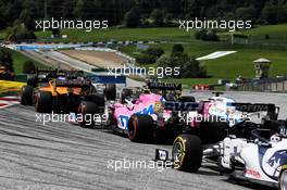Lance Stroll (CDN) Racing Point F1 Team RP20 and George Russell (GBR) Williams Racing FW43 at the start of the race. 12.07.2020. Formula 1 World Championship, Rd 2, Steiermark Grand Prix, Spielberg, Austria, Race Day.