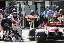 Alfa Romeo Racing makes a pit stop. 12.07.2020. Formula 1 World Championship, Rd 2, Steiermark Grand Prix, Spielberg, Austria, Race Day.