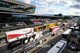 Trucks in the pits and on the start / finish straight - post race pack up.