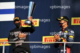 (L to R): Race winner Lewis Hamilton (GBR) Mercedes AMG F1 celebrates on the podium with third placed Alexander Albon (THA) Red Bull Racing. 13.09.2020. Formula 1 World Championship, Rd 9, Tuscan Grand Prix, Mugello, Italy, Race Day.