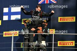Valtteri Bottas (FIN) Mercedes AMG F1 and Lewis Hamilton (GBR) Mercedes AMG F1 celebrate on the podium with a team member. 13.09.2020. Formula 1 World Championship, Rd 9, Tuscan Grand Prix, Mugello, Italy, Race Day.