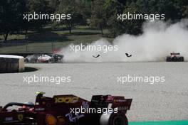Max Verstappen (NLD) Red Bull Racing RB16 crashes out of the race with Romain Grosjean (FRA) Haas F1 Team VF-20. 13.09.2020. Formula 1 World Championship, Rd 9, Tuscan Grand Prix, Mugello, Italy, Race Day.
