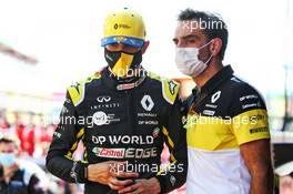 (L to R): Esteban Ocon (FRA) Renault F1 Team with Cyril Abiteboul (FRA) Renault Sport F1 Managing Director in the pits. 13.09.2020. Formula 1 World Championship, Rd 9, Tuscan Grand Prix, Mugello, Italy, Race Day.