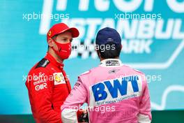 (L to R): third placed Sebastian Vettel (GER) Ferrari with second placed Sergio Perez (MEX) Racing Point F1 Team in parc ferme. 15.11.2020. Formula 1 World Championship, Rd 14, Turkish Grand Prix, Istanbul, Turkey, Race Day.