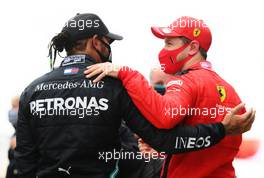 (L to R): Race winner and World Champion Lewis Hamilton (GBR) Mercedes AMG F1 celebrates with Sebastian Vettel (GER) Ferrari in parc ferme. 15.11.2020. Formula 1 World Championship, Rd 14, Turkish Grand Prix, Istanbul, Turkey, Race Day.