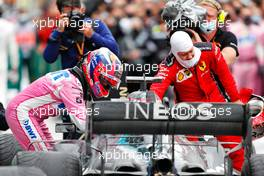 Sergio Perez (MEX) Racing Point F1 Team and Sebastian Vettel (GER) Ferrari congratulate race winner and World Champion Lewis Hamilton (GBR) Mercedes AMG F1 W11 in parc ferme. 15.11.2020. Formula 1 World Championship, Rd 14, Turkish Grand Prix, Istanbul, Turkey, Race Day.